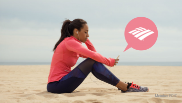 best savings accounts athletic girl on beach with bank of america app